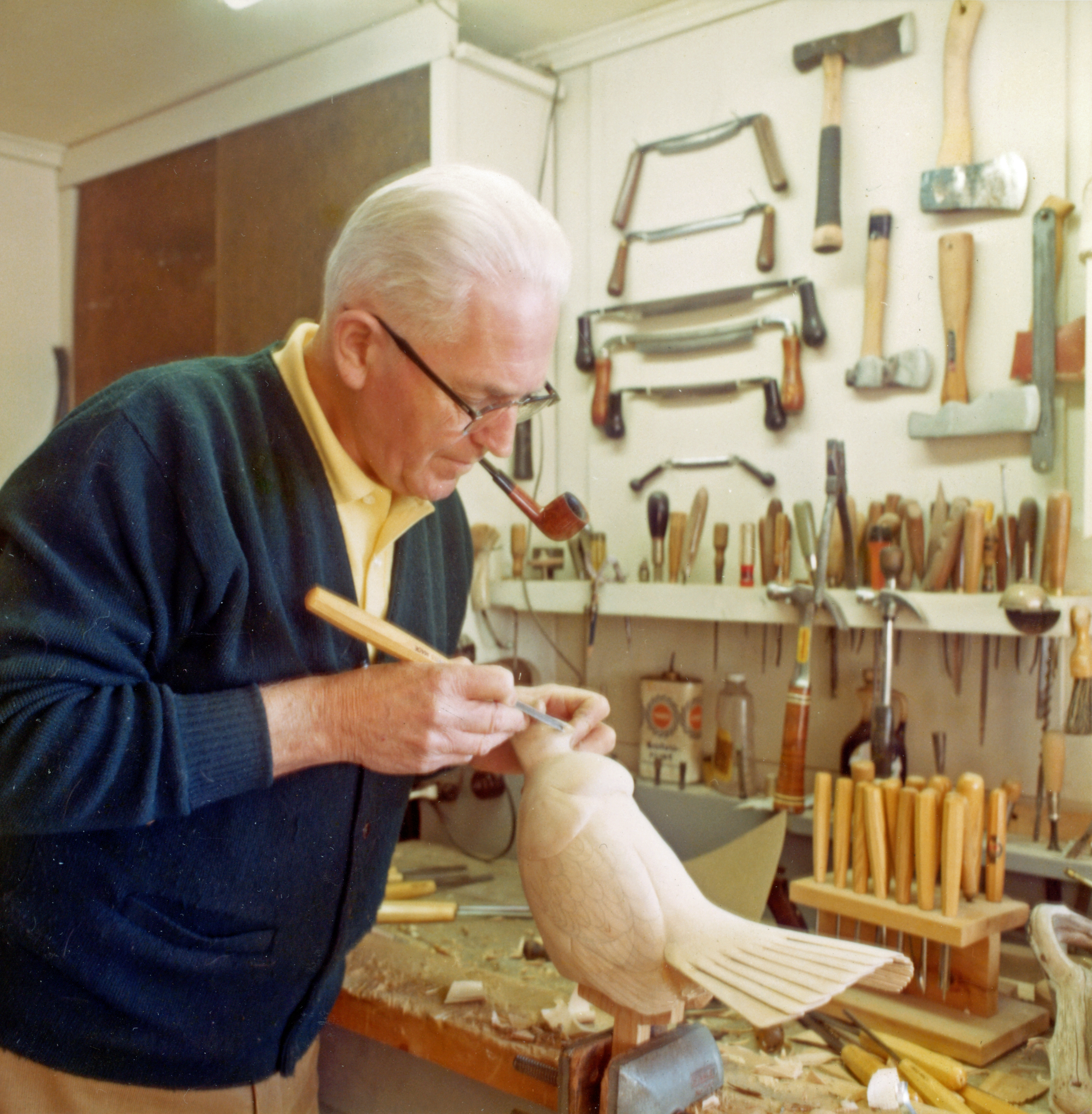 Wendell H. Gilley Carving a Grouse