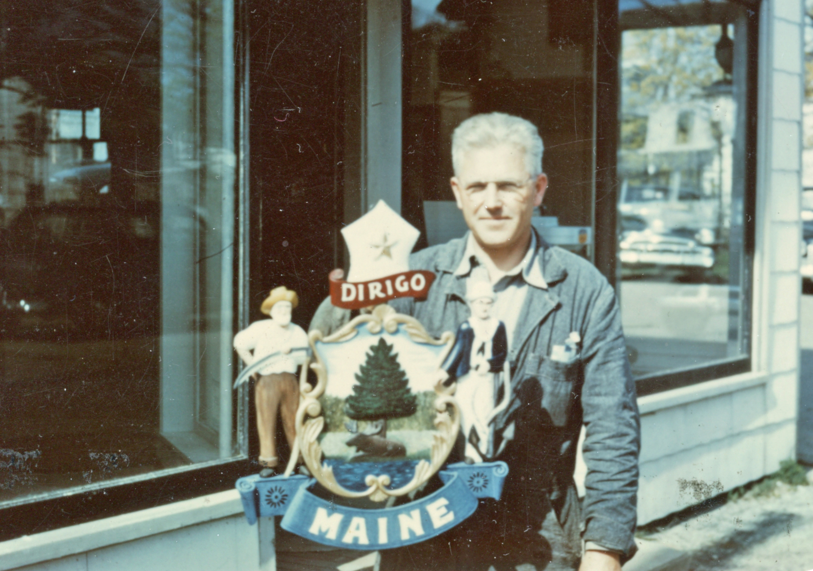 Wendell H. Gilley holding Official Seal of the State of Maine, 1955